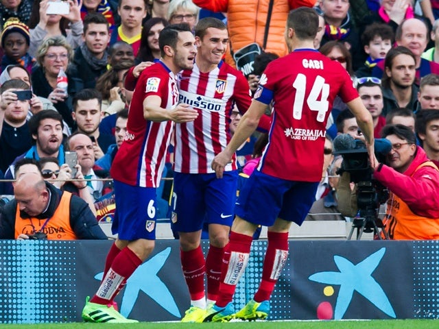 Koke celebrates with Antoine Griezmann and Gabi Fernandez after scoring the opening goal during the La Liga match between FC Barcelona and Club Atletico de Madrid at Camp Nou on January 30, 2016