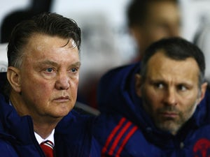 Louis van Gaal and Ryan Giggs look on prior to during the FA Cup fourth-round match between Derby County and Manchester United at iPro Stadium on January 29, 2016