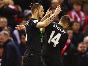 Marko Arnautovic celebrates scoring during the League Cup match between Liverpool and Stoke City on January 26, 2016
