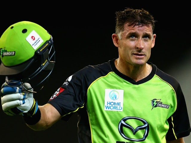 Michael Hussey walks off after being dismissed by Adam Zampa during the Big Bash League final match between Melbourne Stars and the Sydney Thunder at Melbourne Cricket Ground on January 24, 2016