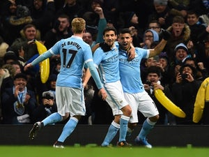 Sergio Aguero celebrates scoring the winner during the League Cup game between Manchester City and Everton on January 27, 2016