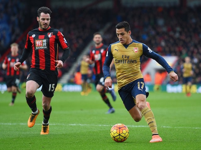 Adam Smith and Alexis Sanchez in action during the Premier League game between Bournemouth and Arsenal on February 7, 2016