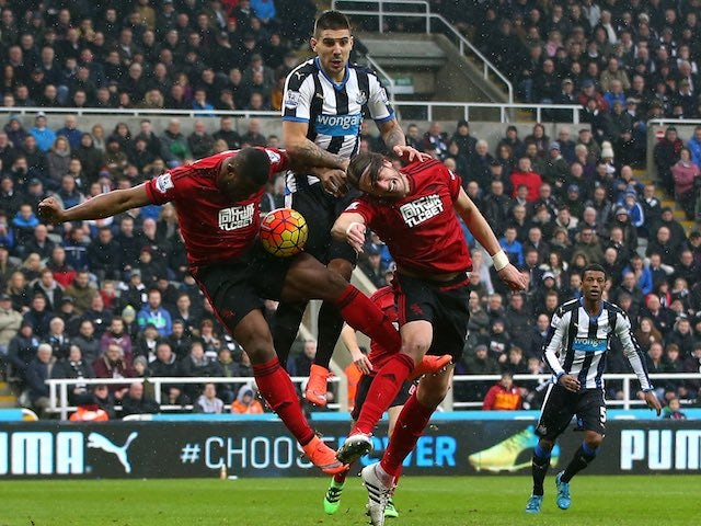 Aleksandar Mitrovic rises highest above Victor Anichebe and Jonas Olsson during the Premier League game between Newcastle United and West Bromwich Albion on February 6, 2016