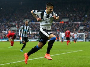 Aleksandar Mitrovic shows off a white vest after scoring during the Premier League game between Newcastle United and West Bromwich Albion on February 6, 2016