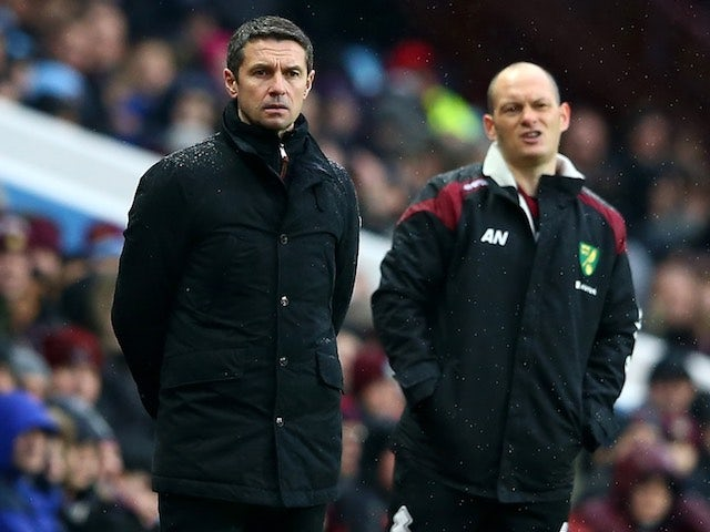 Alex Neil and Remi Garde watch on during the Premier League game between Aston Villa and Norwich City on February 6, 2016