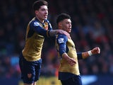 Alex Oxlade-Chamberlain is rewarded by Hector Bellerin during the Premier League game between Bournemouth and Arsenal on February 7, 2016