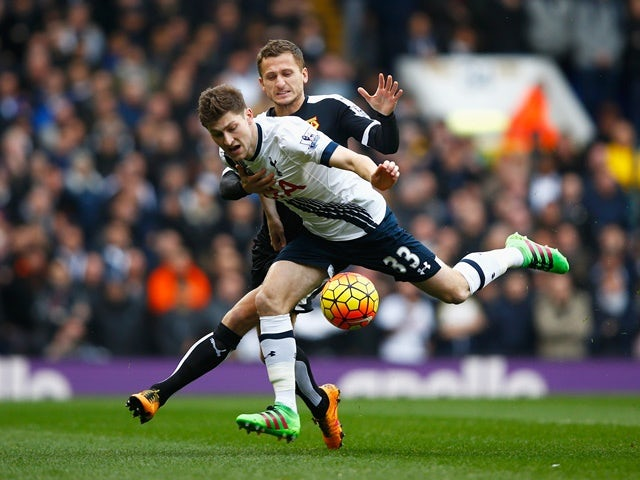 Ben Davies and Almen Abdi compete for the ball during the Premier League match between Tottenham Hotspur and Watford at White Hart Lane on February 6, 2016