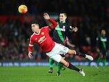 Chris Smalling and Bojan Krkic in action during the Premier League game between Manchester United and Stoke on February 2, 2016