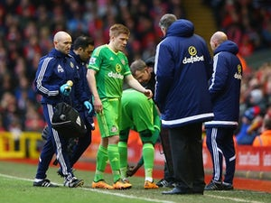 An injured Duncan Watmore walks off the pitch during the Premier League game between Liverpool and Sunderland on February 6, 2016