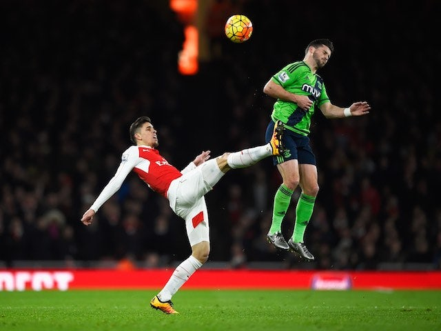 Gabriel and Shane Long in action during the Premier League game between Arsenal and Southampton on February 2, 2016