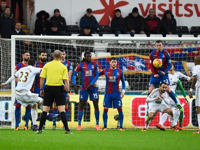 Gylfi Sigurdsson scores Swansea City's first goal from a free kick against Crystal Palace at the Liberty Stadium on February 6, 2016
