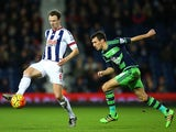 Jack Cork and Jonny Evans in action during the Premier League game between West Brom and Swansea on February 2, 2016