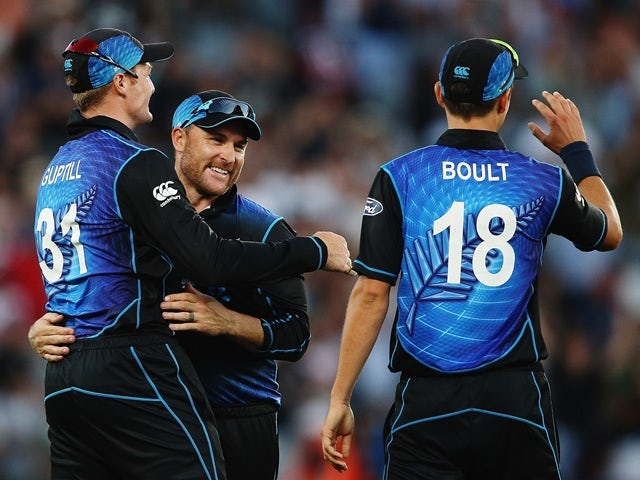 Martin Guptill, Brendon McCullum and Trent Boult celebrate after winning the one-day international match between New Zealand and Australia at Eden Park on February 3, 2016