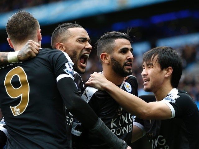 Riyad Mahrez celebrates with teammates during the Premier League game between Manchester City and Leicester City on February 6, 2016