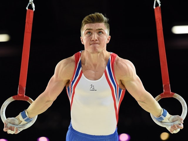 Sam Oldham competes in a qualifying round of the rings event of the European Men's Artistic Gymnastics Championships on April 16, 2015