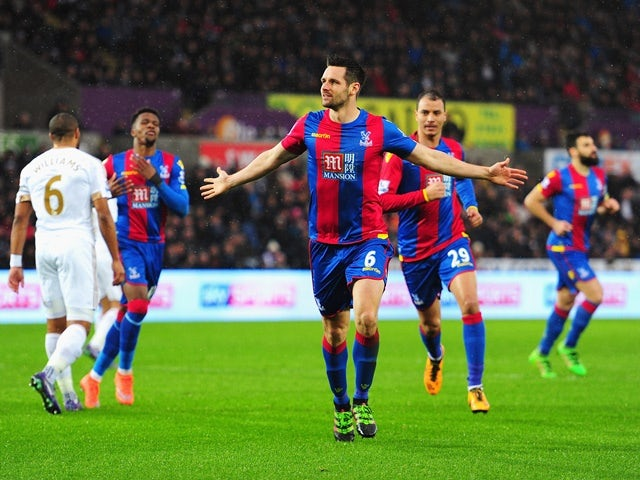 Scott Dann celebrates scoring during the Premier League match between Swansea City and Crystal Palace on February 6, 2016