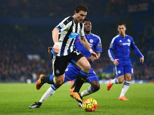 Baba Rahman vies with Daryl Janmaat while Eden Hazard pulls faces during the Premier League game between Chelsea and Newcastle United on February 13, 2016