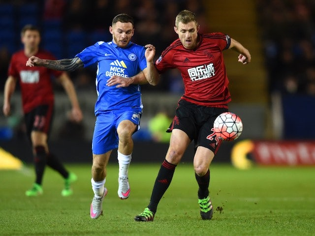 Darren Fletcher and Jon Taylor in action during the FA Cup replay between Peterborough United and West Bromwich Albion on February 10, 2016