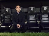 Gary Neville sits in the dugout during the Copa del Rey semi between Valencia and Barcelona on February 10, 2016