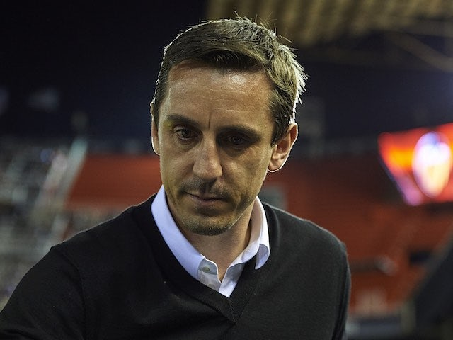 "Gary Neville labels ref a ""joke"""