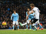 Harry Kane scores from the penalty spot during the Premier League match between Manchester City and Tottenham Hotspur on February 14