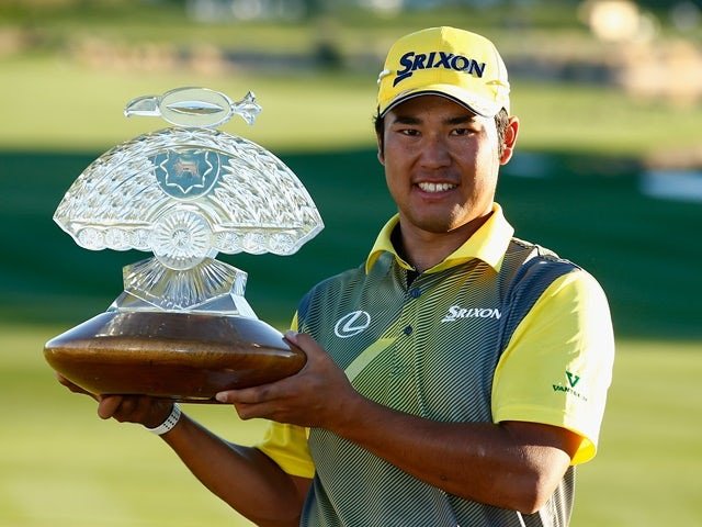 Hideki Matsuyama  poses with the winners trophy on the 18th hole of the Waste Management Phoenix Open at TPC Scottsdale on February 7, 2016