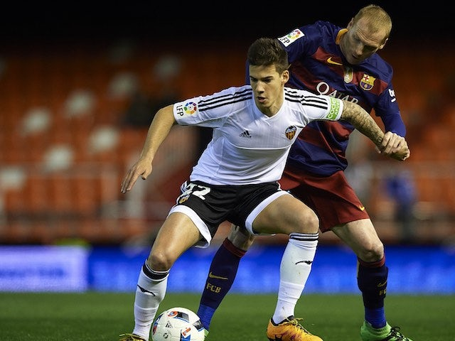 Jeremy Mathieu and Santi 'look into my thighs, look into my thighs' Mina in action during the Copa del Rey semi between Valencia and Barcelona on February 10, 2016