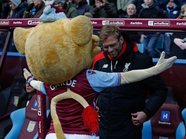 Jurgen Klopp receives a hug from Hercules The Lion ahead of the Premier League game between Aston Villa and Liverpool on February 14, 2016