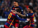 Lionel Messi celebrates with his teammates Neymar and Dani Alves after scoring the opening goal during the La Liga match between Barcelona and Celta Vigo on February 14, 2016
