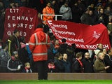 Liverpool fans protest against ticket prices during the FA Cup fourth-round replay against West Ham United on February 9, 2016