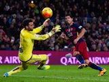 Luis Suarez scores Barcelona's second goal past Sergio Alvarez during the La Liga match against Celta Vigo at Camp Nou on February 14, 2016