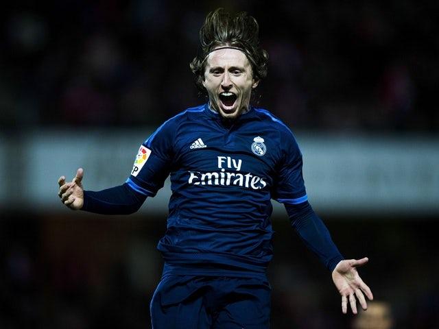 Luka Modric celebrates scoring during the La Liga match between Granada  and Real Madrid on February 7, 2016