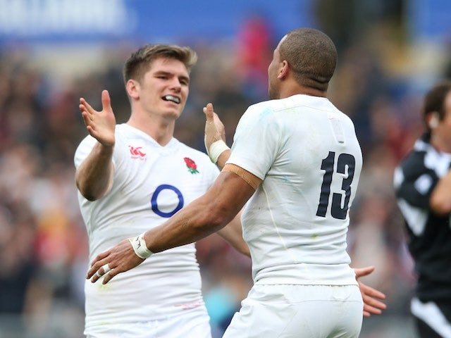 Bros Owen Farrell and Jonathan Joseph celebrate during the Six Nations game between Italy and England on February 14, 2016