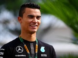 Pascal Wehrlein arrives in the paddock before final practice for the Formula 1 Grand Prix of Singapore at Marina Bay Street Circuit on September 19, 2015