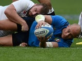Sergio Parisse receives a cuddle from Jack Nowell during the Six Nations game between Italy and England on February 14, 2016