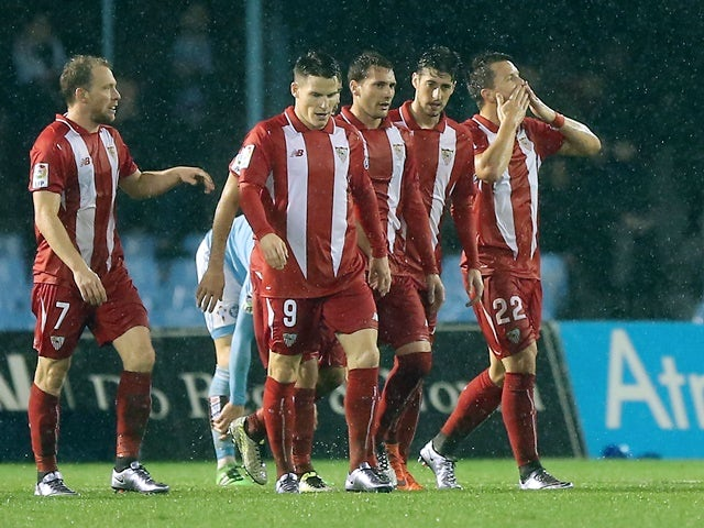 Sevilla's Yevhen Konoplyanka celebrates a goal with teammates during the  Copa del Rey semi-final second leg against Celta Vigo on February 11, 2016