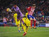 Alphonse 'Hands off my' Areola saves a shot from Fernando Torres during the La Liga game between Atletico Madrid and Villarreal on February 20, 2016