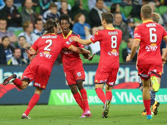Bruce Kamau is congratulated by teammates after scoring during the A-League match between Melbourne Victory and Adelaide United on February 19, 2016
