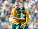 Chris Morris and Faf du Plessis celebrate during the second T20 between South Africa and England on February 20, 2016