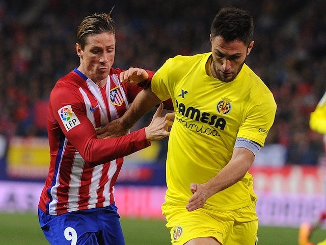 Blond bombshell Fernando Torres and Victor Ruiz during the La Liga game between Atletico Madrid and Villarreal on February 20, 2016