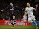 Gary Cahill battles with Angel Di Maria during the Champions League encounter between Paris Saint-Germain and Chelsea on February 16, 2016
