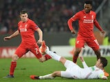 James Milner, Daniel Sturridge and Paul Verhaegh in action during the Europa League game between Augsburg and Liverpool on February 18, 2016