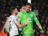 Joel Robles of Everton is congratulated by teammates Tom Cleverley and Ramiro Funes Mori after stopping a penalty kick during the FA Cup fifth-round match against Bournemouth on February 20, 2016
