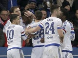 John Obi Mikel is congratulated by teammates after scoring during the Champions League encounter between Paris Saint-Germain and Chelsea on February 16, 2016