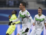 Wolfsburg's Julian Draxler reacts after scoring against Gent on February 17, 2016