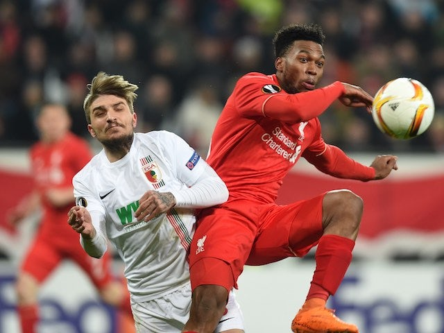 Konstantinos Stafylidis and Daniel Sturridge in action during the Europa League game between Augsburg and Liverpool on February 18, 2016