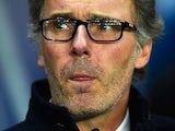 Laurent Blanc licks his lower lip as he observes the on-the-field action during the Champions League encounter between Paris Saint-Germain and Chelsea on February 16, 2016