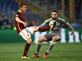 Roma's Lucas Digne vies with Real Madrid's Dani Carvajal during the Champions League match on February 17, 2016