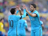 Luis Suarez and Lionel Messi celebrate during the La Liga game between Las Palmas and Barcelona on February 20, 2016
