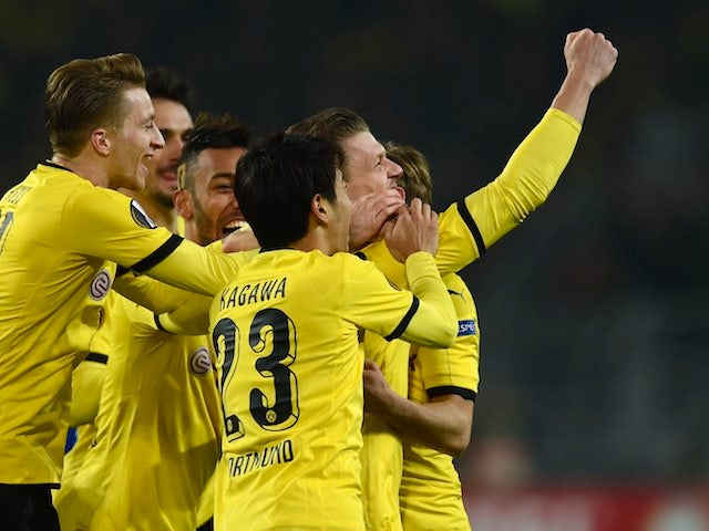 Lukasz Piszczek celebrates with teammates during the Europa League game between Borussia Dortmund and Porto on February 18, 2016